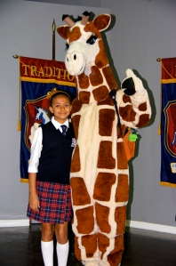 Fifth grade student Jade with Jade the Giraffe
