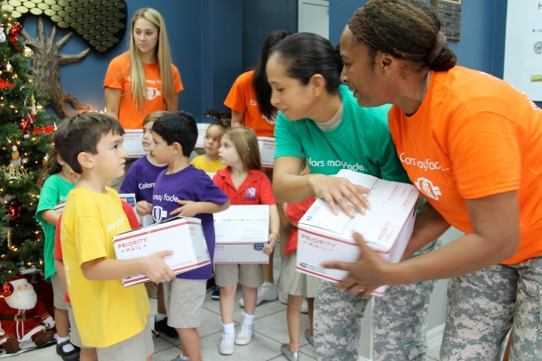 Early Childhood students help soldiers load care packages for shipment.