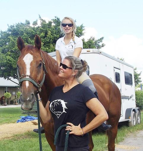 Kathleen Hayden, who volunteers with Horses Healing Hearts, leads her horse Westin. (Sun-Sentinel)