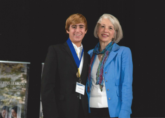 Tasman Rosenfeld receives accolades from Elaine Hansen, executive director of the Center for Talented Youth (CTY).