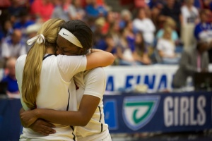 Lady Pride players celebrate after the state championship win.