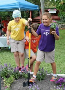 Randall and friends plant flowers during the Seeds of Hope event.