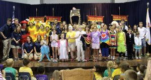 Talent Show participants take a bow with Randall at center stage.
