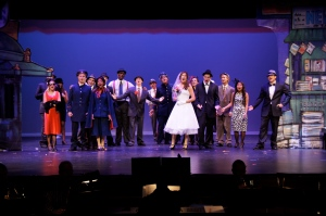 Upper school students perform in Guys and Dolls in May 2014.