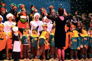 Students perform Jingle Bells amidst falling snow in the 2014 Winter Concert.