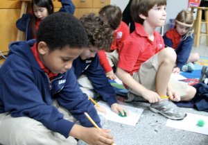 "First grade students ""programmed"" fuzzball robots by giving them directions to move through a maze."