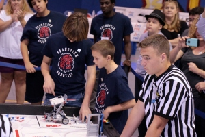 Students complete the Robot Game challenge during a FIRST LEGO League Competition.