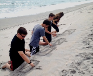 Calculating measurements of quadrilaterals on the beach.