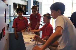 Junior Matthew Schner keeps a heartbeat with his lower school buddies.